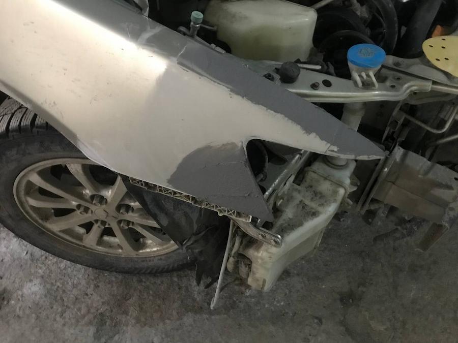 Фото процесса восстановления крыла Lancer